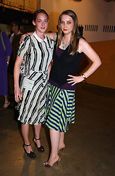 Left to right, POPPY DE VILLENEUVE and her sister DAISY DE VILLENEUVE at a party to celebrate the opening of an exhibition by Daisy de Villeneuve at the Fashion and Textile Museum, Bermondsey Street, London SE1 on 25th June 2004.
