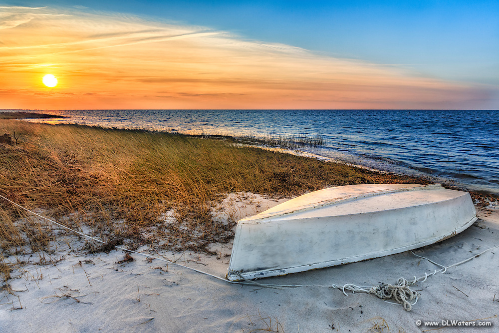 Overturned boat at sunset on Cape Hatteras Island.