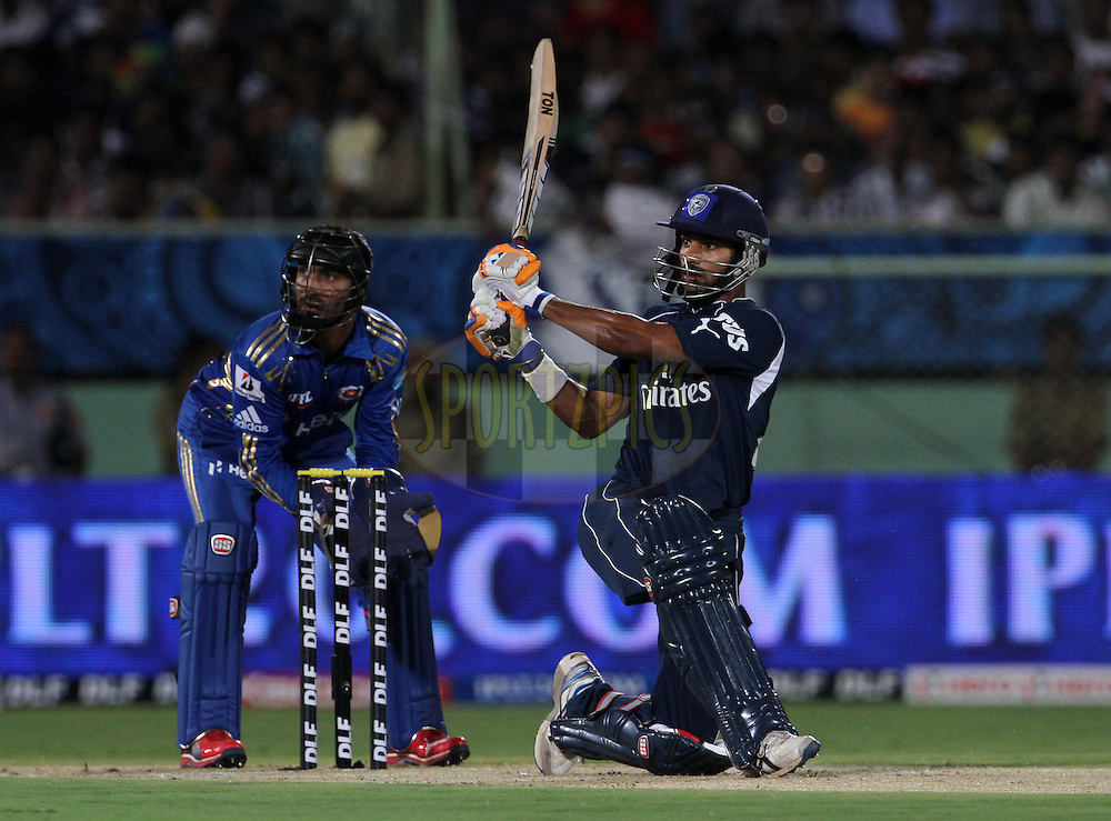 Deccan Chargers player Shikhar Dhawan plays a shot during match 9 of the the Indian Premier League ( IPL) 2012  between The Deccan Chargers and the Mumbai Indians held at the ACA-VDCA Stadium, Visakhapatnam on the 9th April 2012..Photo by Vipin Pawar/IPL/SPORTZPICS