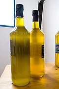 Bottles of freshly pressed virgin olive oil
