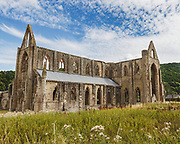 """Tintern Abbey was founded in 1131 and sits on the Welsh bank of the River Wye, the (current) border of England and Wales. Used by the Cistercian monks until 1536 and Henry VIII's Dissolution of the Monasteries. The monastery fell into ruin and we are lucky that so much still stands today. Amusing aside - it also features in Iron Maiden's """"Can I play with madness"""" video"""