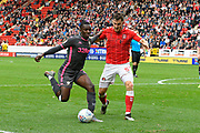 Edward Nketiah (14) of Leeds United battles for possession with Tom Lockyer (5) of Charlton Athletic during the EFL Sky Bet Championship match between Charlton Athletic and Leeds United at The Valley, London, England on 28 September 2019.