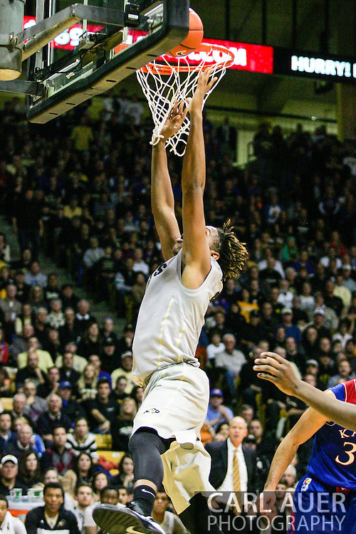 December 7th, 2013:  Colorado Buffaloes sophomore forward Xavier Johnson (2) throws up a off balance shot in the second half of action in the NCAA Basketball game between the Kansas Jayhawks and the University of Colorado Buffaloes at the Coors Events Center in Boulder, Colorado