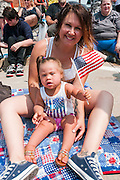 Mother and daughter at the Fourth of July parade in Ames, Iowa