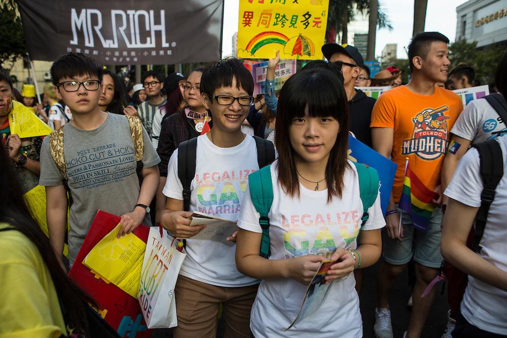 """Young students march in the LGBT Pride. The annual march through Taipei's city streets is the largest in Asia, with well over 50 000 people taking part. The 2014 event had the theme """"Walk in Queer's Shoes"""", to encourage the wider community to lend their support for equal marriage rights."""
