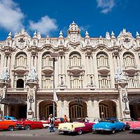 Vintage cars parked outside the Gran Teatro de La Habana, Havana, Cuba.