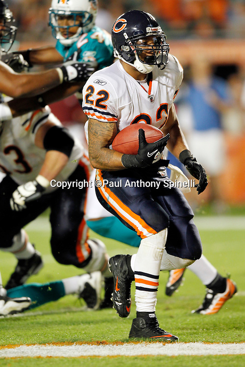 Chicago Bears running back Matt Forte (22) scores a touchdown on a 2 yard run that gives the Bears a 16-0 third quarter lead during the NFL week 11 football game against the Miami Dolphins on Thursday, November 18, 2010 in Miami Gardens, Florida. The Bears won the game 16-0. (©Paul Anthony Spinelli)