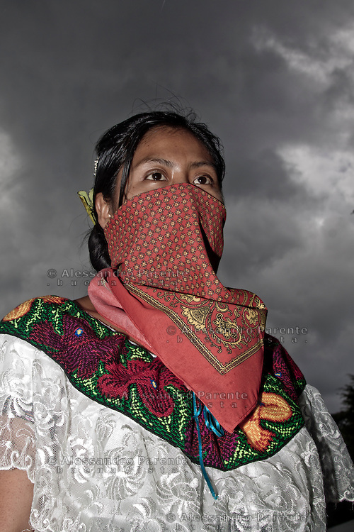 A woman wearing a shawl. They cannot reveal them identities.<br />