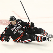 Josh Manson #3 of the Northeastern Huskies falls to the ice during The Beanpot Championship Game at TD Garden on February 10, 2014 in Boston, Massachusetts. (Photo by Elan Kawesch)