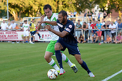 21.07.2015, Singen, SUI, Testspiel, VfL Wolfsburg vs FC Zuerich, im Bild Marcel Schaefer (Wolfsburg) gegen Yassine Chikhaoui (Zuerich) // during the International Friendly Football Match between VfL Wolfsburg and FC Zuerich at Singen, Switzerland on 2015/07/21. EXPA Pictures © 2015, PhotoCredit: EXPA/ Freshfocus/ Claudia Minder<br /> <br /> *****ATTENTION - for AUT, SLO, CRO, SRB, BIH, MAZ only*****