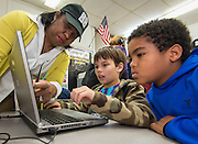 Houston ISD trustee Paula Harris watches students work a coding exercise during an Hour of Code at Kolter Elementary School, December 10, 2014.