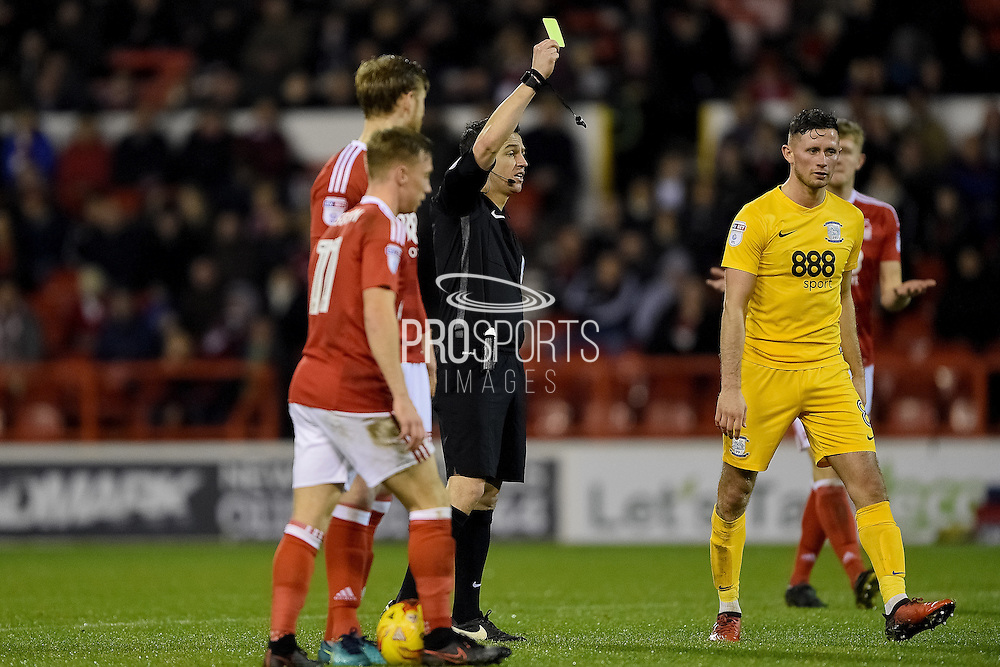 Tony Harrington shows a yellow card to Preston North End midfielder Alan Browne (8) during the EFL Sky Bet Championship match between Nottingham Forest and Preston North End at the City Ground, Nottingham, England on 14 December 2016. Photo by Jon Hobley.