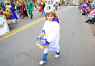 12/1/12 12:54:07 PM - Souderton, PA: .A young girl hands out candy as they march on Main Street during the Souderton/Telford Holiday Parade December 1, 2012 in Souderton, Pennsylvania -- (Photo by William Thomas Cain/Cain Images)