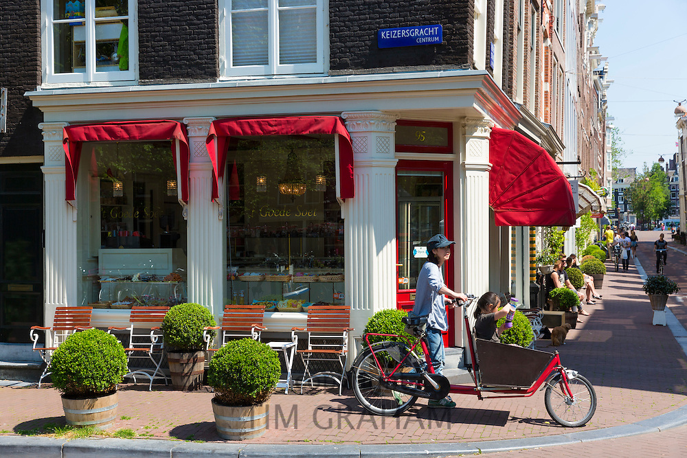 Cyclist in Keizersgracht in the Nine Streets - De Negen Straatjes - 9 Streets district of Jordaan, Amsterdam