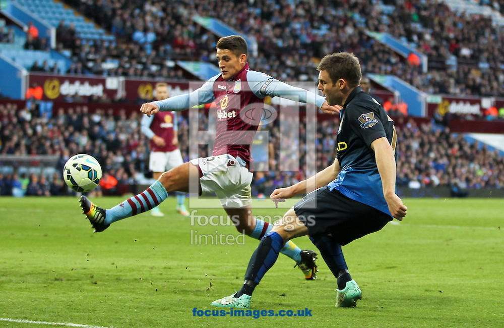 James Milner (right) of Manchester City crosses the ball past Ashley Westwood (left) of Aston Villa during the Barclays Premier League match at Villa Park, Birmingham<br /> Picture by Tom Smith/Focus Images Ltd 07545141164<br /> 04/10/2014