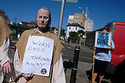Extinction Rebellion Activists The Penitents, protest about the climate emergency on 20th September 2019 in Penzance, United Kindom. The Penitents who were a Christian movement that goes back to the 4th century. Those who had committed serious sins confessed their sins to the Bishop or his representative and were assigned a penance that was to be carried out over a period of time. These protests are highlighting that the government is not doing enough to avoid catastrophic climate change and to demand the government take radical action to save the planet.
