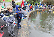 Eghan Anderson (left), 9 and Rogan Anderson, 9 of Glenside, Pennsylvania cast their lines into the water on the first day of trout season at Fanny Chapman Pond Saturday April 2, 2016 in Doylestown, Pennsylvania.  (Photo by William Thomas Cain)