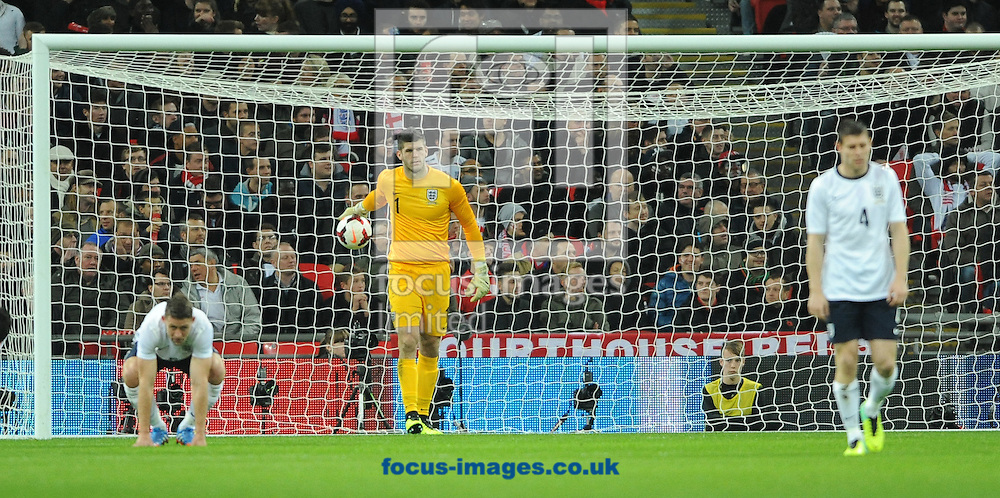Picture by Daniel Hambury/Focus Images Ltd +44 7813 022858<br /> 15/11/2013<br /> Fraser Forster of England reacts after conceding an early goal during the Friendly match at Wembley Stadium, London.