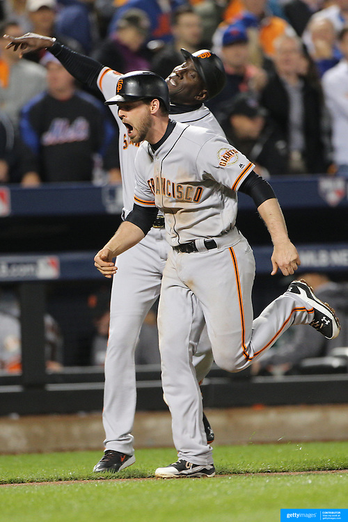 NEW YORK, NEW YORK - October 5: Conor Gillaspie #21 of the San Francisco Giants celebrates as he runs the bases after hitting a three run home run in the top of the ninth during the San Francisco Giants Vs New York Mets National League Wild Card game at Citi Field on October 5, 2016 in New York City. (Photo by Tim Clayton/Corbis via Getty Images)