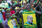 Dar es Salaam, Tanzania - 10/29/15 - A man salutes after ruling party Chama Cha Mapinduzi (CCM) candidate John Magufuli was named president-elect by the National Electoral Commission in Dar es Salaam, Tanzania on October 29.  Photo by Daniel Hayduk