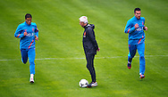 NETHERLANDS, HOENDERLOO : Dutch international football player Ibrahim Afellay (l) with Robin van Persie with in the middle coach Bert van Marwijk  at the trainingcamp of the Netherlands national football team in Hoenderloo on May 31, 2012. AFP PHOTO/ ROBIN UTRECHT