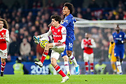Chelsea midfielder Willian (10) tussles with Arsenal defender Héctor Bellerín (2) during the Premier League match between Chelsea and Arsenal at Stamford Bridge, London, England on 21 January 2020.