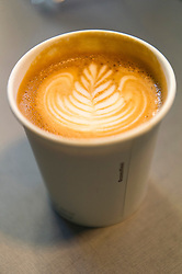 © Licensed to London News Pictures. 07/04/2016. Cup of cafe latte on a stand at The London Coffee Festival. Now its 4th year, will attract over 35,00 visitors over the four day event. London, UK. Photo credit: Ray Tang/LNP
