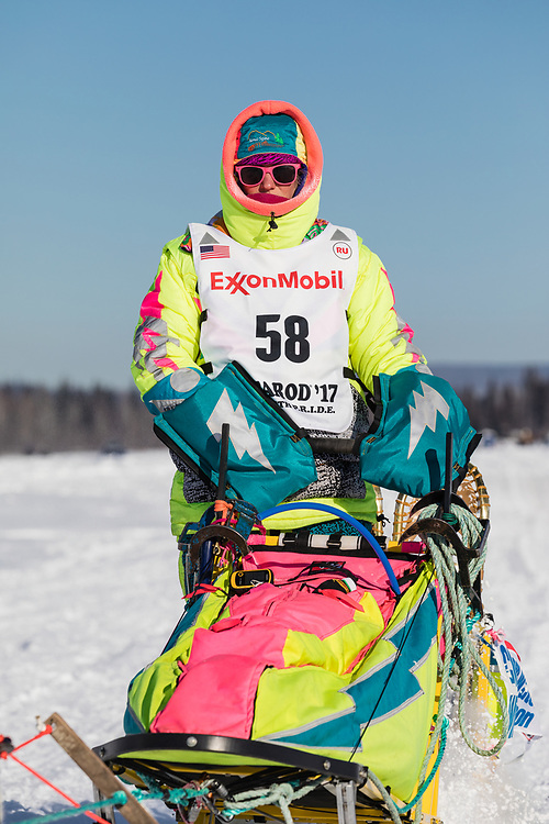 Musher Monica Zappa competing in the 45rd Iditarod Trail Sled Dog Race on the Chena River after leaving the restart in Fairbanks in Interior Alaska.  Afternoon. Winter.