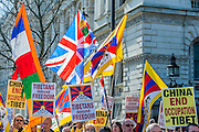 Organisations calling for a free Tibet hand in a petition to Number 10 Downing Street and then march on the Chinese embassy.  At the same time supporters of a non-Russian Ukraine try to make the UK government aware of the consequences of another super-power land grab. Whitehall, London, UK 15 March 2014. Guy Bell, 07771 786236, guy@gbphotos.com