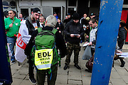 English Defence League (EDL) demonstration<br /> called in protest to the proposed building of a new mosque in Dudley.<br /> A member of the English Defence League media team distributes leaflets and press releases to supporters.