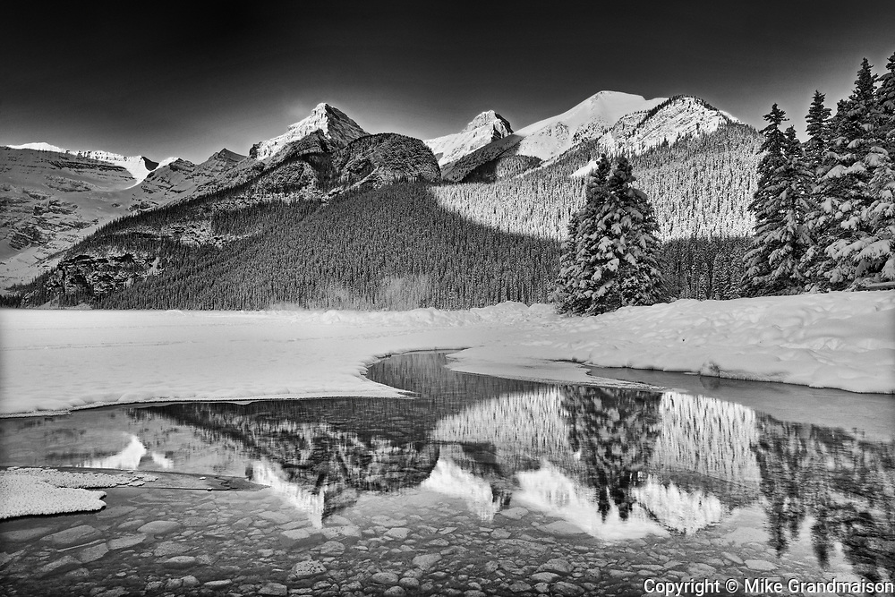 The Canadian Rocky Mountains reflected in Lake Louise at sunrise, Banff National Park, Alberta, Canada<br />Banff National Park<br />Alberta<br />Canada