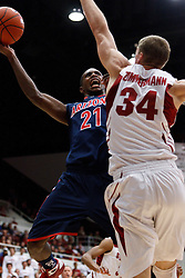 February 3, 2011; Stanford, CA, USA;  Arizona Wildcats guard Kyle Fogg (21) shoots over Stanford Cardinal forward Andrew Zimmermann (34) during the first half at Maples Pavilion.