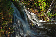Waterfall on Crow Lake at sunset<br />