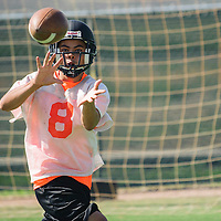 080404       Adron Gardner<br /> <br /> Gallup Bengal Ernesto Zarate (8) catches a pass during football practice at Gallup High School in Gallup Monday.