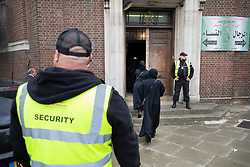 © Licensed to London News Pictures. 19/09/2018. London, UK. Private security guards watch over the entrance to The Hussaini Association Islamic Centre in Cricklewood, north London where a car hit two pedestrians last night. The incident , which took place in the early hours of this morning outside the centre, is being treated as a possible hate crime. Police are looking for a male driver who failed to stop at the scene, as well as two men and one woman in the car, all in their 20s. Photo credit: Peter Macdiarmid/LNP