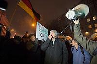 """05 JAN 2015, BERLIN/GERMANY:<br /> Dr. Karl Schmitt (M), vom Verein """"Patrioten"""", Anmelder der Bärgida-Demo """"Berliner Patrioten gegen die Islamisierung des Abendlandes"""", haelt mit Hilfe eines Megafons eine Rede, Baergida Demo, Spandauer Strasse<br /> IMAGE: 20150105-01-053<br /> KEYWORDS: Bärgida, Demonstranten, Protest, Demonstration,"""