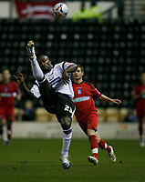 Darren Moore with an overhead clearance.  Jamie Cureton closes him down.