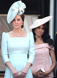 File photo dated 09/06/18 of the Duchess of Cambridge (left) and the Duchess of Sussex on the balcony of Buckingham Palace, in central London, following the Trooping the Colour ceremony at Horse Guards Parade as the Queen celebrates her official birthday. On March 31, Meghan will bow out of royal life just one year, 10 months and 12 days ??? or 682 days ??? after marrying into the family. The PA news agency take a look at Meghan's time as a Royal.