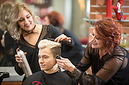 """Mother and daughter Tammy and Lauren Muniz  work in their salon """"Rouge 22"""" on January 2, 2017. The hairstyling duo are being recognized in Sola Salon Studios' """"2017 Faces of Sola"""" campaign. © Dan Henry / BiciPhoto.com"""