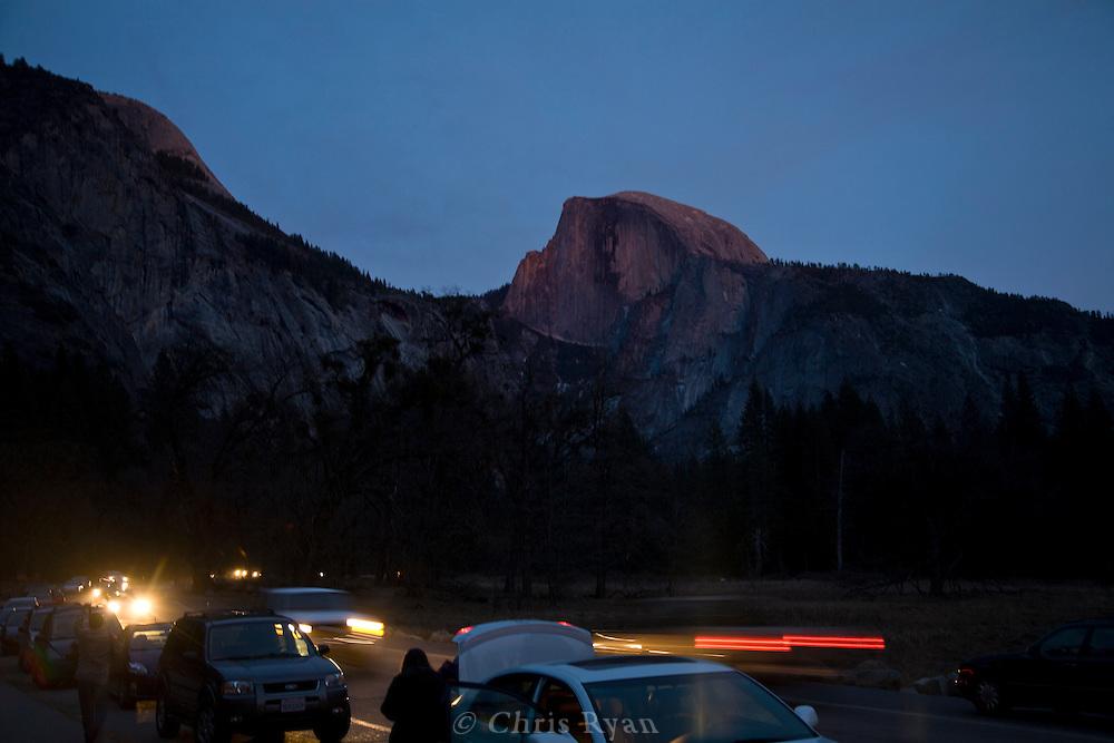 Park traffic and Half Dome at dusk, Yosemite National Park, California