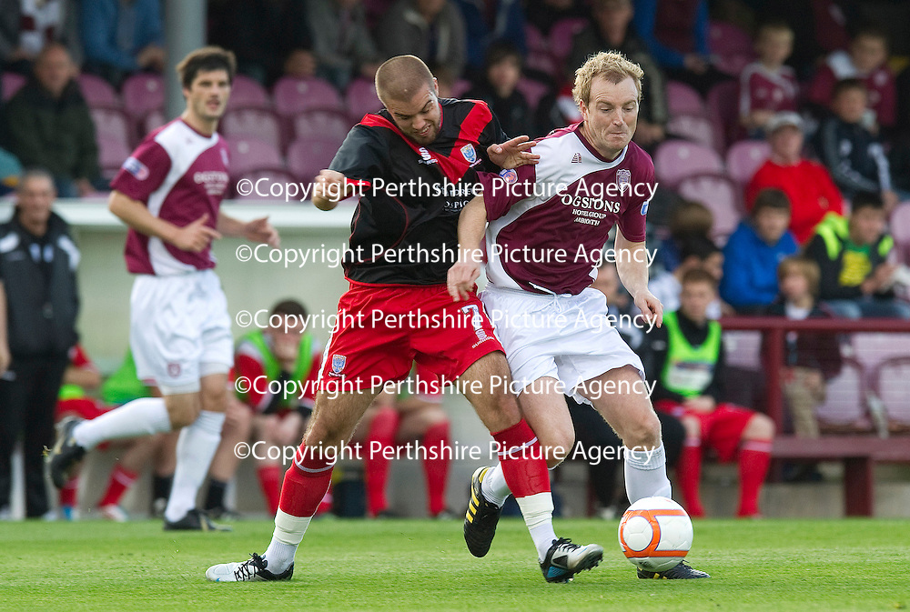 Arbroath v Airdrie Utd...17.09.11   <br /> Brian Kerr and Graeme Owens battle<br /> Picture by Graeme Hart.<br /> Copyright Perthshire Picture Agency<br /> Tel: 01738 623350  Mobile: 07990 594431