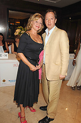 KAY SAATCHI and GEORDIE GREIG at a party to celebrate the 180th Anniversary of The Spectator magazine, held at the Hyatt Regency London - The Churchill, 30 Portman Square, London on 7th May 2008.<br />