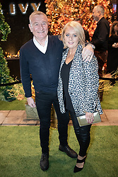 © Licensed to London News Pictures . 23/11/2018. Manchester , UK . Radio presenter Mike Sweeney (l) arrives at an opening event of The Ivy restaurant and bar venue in Spinningfields in Manchester City Centre . Photo credit : Joel Goodman/LNP