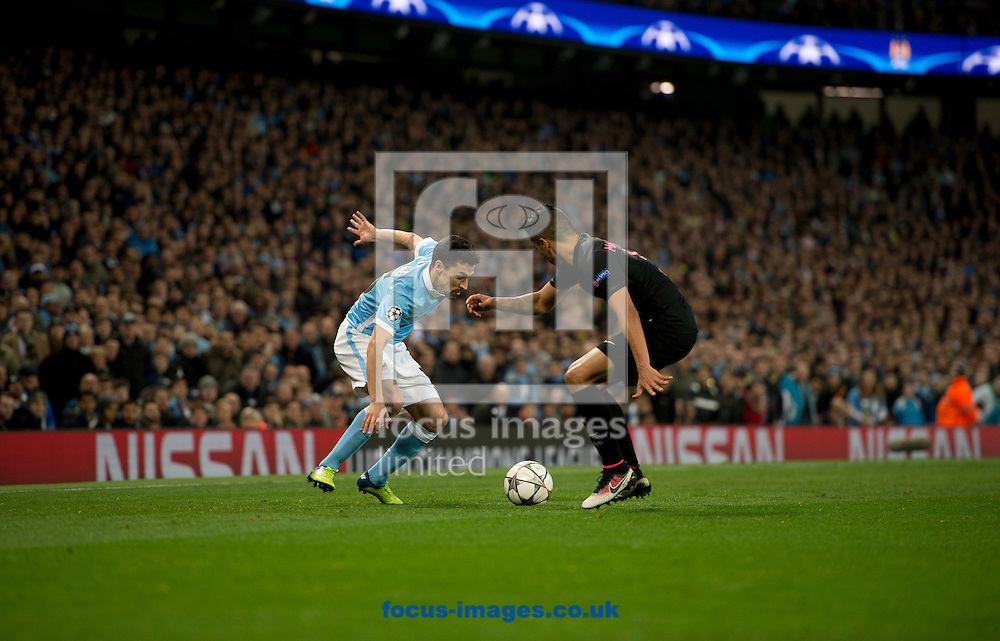 Jesus Navas of Manchester City (left) looks to find a way past Marquinhos of Paris Saint-Germain during the UEFA Champions League match at the Etihad Stadium, Manchester<br /> Picture by Russell Hart/Focus Images Ltd 07791 688 420<br /> 12/04/2016