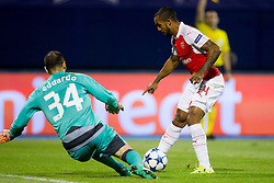 Eduardo Carvalho #24 of GNK Dinamo Zagreb and Theo Walcott #14 of Arsenal F.C. during football match between GNK Dinamo Zagreb, CRO and Arsenal FC, ENG in Group F of Group Stage of UEFA Champions League 2015/16, on September 16, 2015 in Stadium Maksimir, Zagreb, Croatia. Photo by Urban Urbanc / Sportida