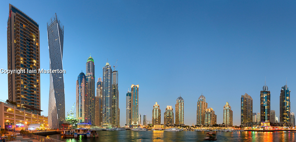 Many modern skyscrapers at dusk at Marina district in Dubai United Arab Emirates