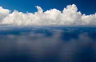 A view of calm sea and clouds from the steep cliffs at Cabo Girao, Madeira, Portugal