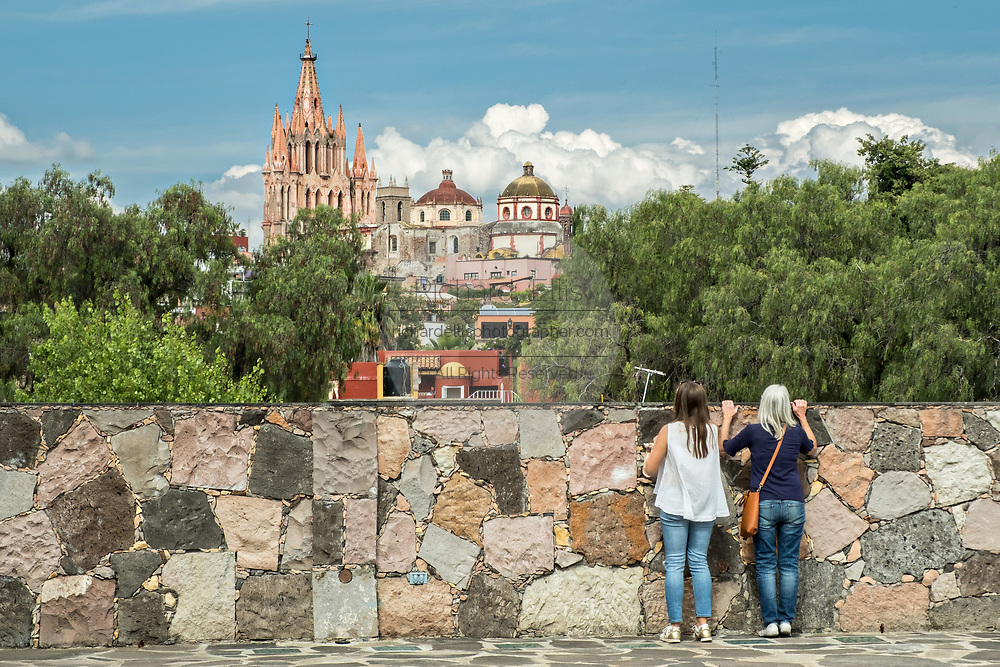 Domes and spires of the Parroquia San Miguel Arcangel church viewed from Instituto Allende in the historic district of San Miguel de Allende, Mexico.