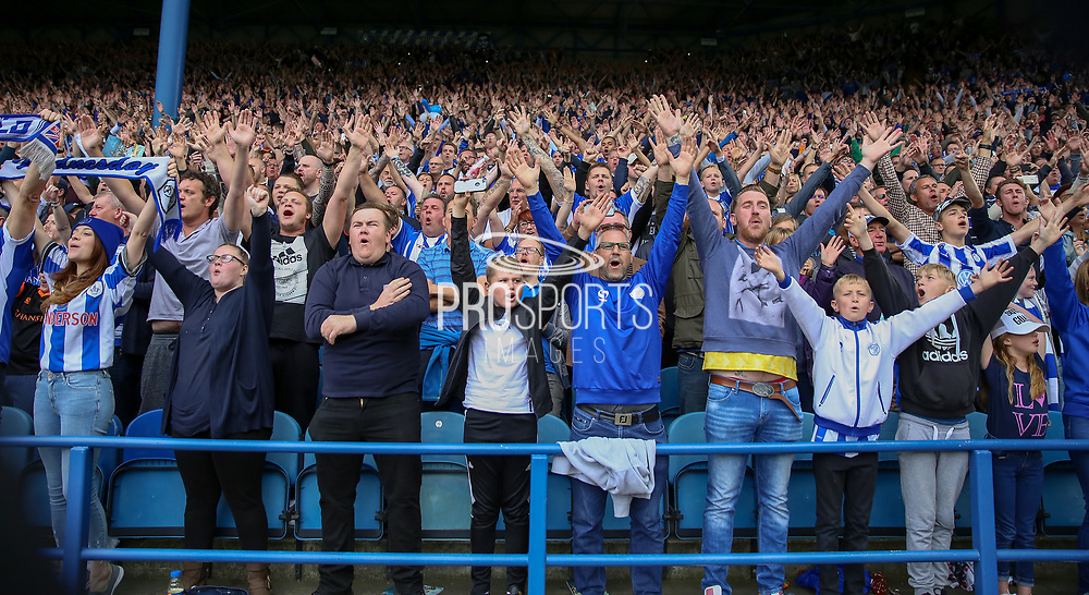 Sheffield Wednesday fans sing during the EFL Sky Bet Championship match between Sheffield Wednesday and Sheffield Utd at Hillsborough, Sheffield, England on 24 September 2017. Photo by Phil Duncan.