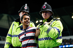 A pitch invader is led away by police - Photo mandatory by-line: Rogan Thomson/JMP - 07966 386802 - 24/08/2014 - SPORT - FOOTBALL - Manchester, England - Etihad Stadium - Manchester City v Sheffield Wednesday - Capital One Cup, Third Round.